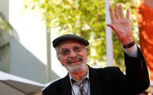Actor Landau waves at a ceremony for director Tim Burton to place his handprints and footprints in cement in the forecourt of the TCL Chinese theatre in Hollywood